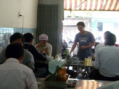 Hai serving his customers at Đong Hoa Xuân