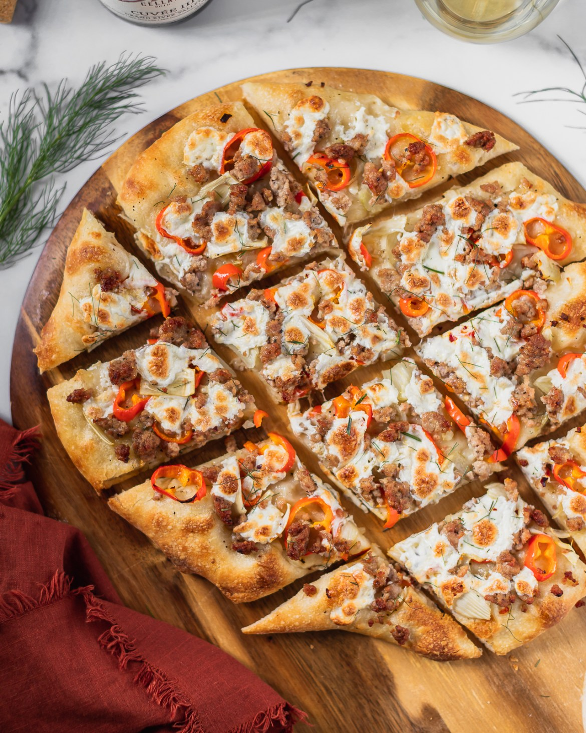 homemade fennel and sausage pizza paired with a white wine