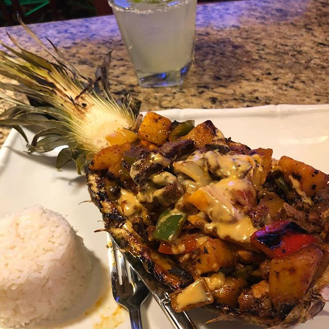 Piña Tropical! Yes it is served in a hollowed our pineapple. And it's delicious. went off the beaten path and discovered something amazing. Are you always ordering or eating the same old thing? Try letting someone else order for you. You may be pleasantly surprised. For individualized performance and nutrition coaching DM us or follow the link in our bio and Start Today! #eatmorebefit #flexibledieting #flexibleeating #macros #iifym #pineapple #mexican #mexicanfood #carbs #margarita #dinner #tuesday #nutrition #diet #foodporn #food #realfood #personaltrainer #ifpa #tequila