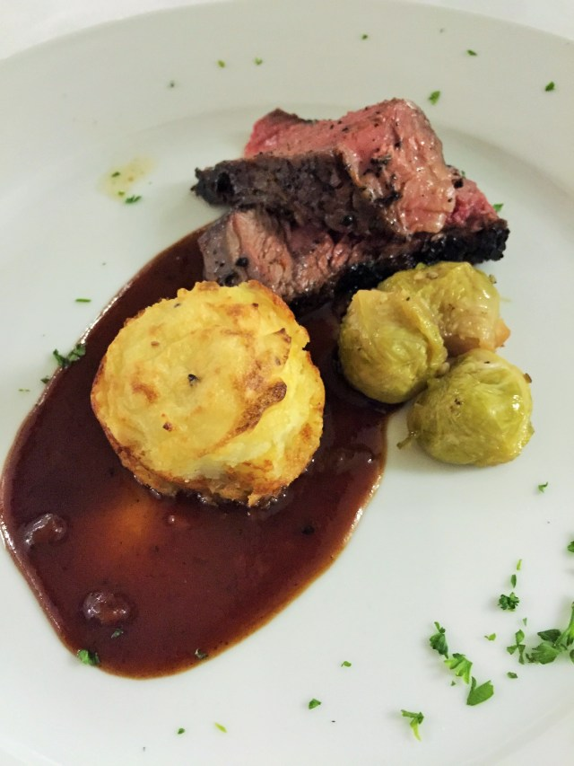 Coffee-Rubbed Rib-Eye Steak - Cabernet Reduction, Gruyere Mash and Maple -Glazed Brussels.