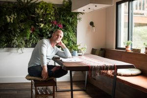 Tim Ferriss In Grey Shirt Sitting At Table