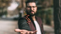 Guy Appearing to Levitate Seeds Above His Hand