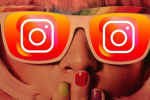 Girl Wearing Glasses with Instagram Logo