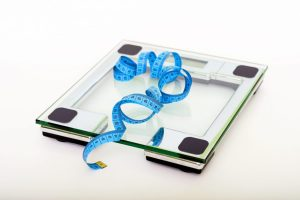 Blue Measuring Tape on Clear Square Glass Scale