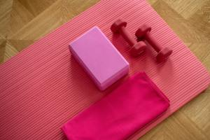 Pink Dumbbells on Pink Yoga Mat