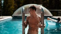 Guy Climbing Out of Pool Shirtless Showing Abs