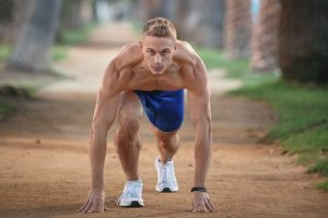 Shirtless Guy Preparing to Run From Crouched Position