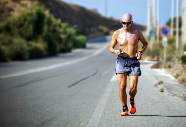Guy Running On Road With Shirt Off