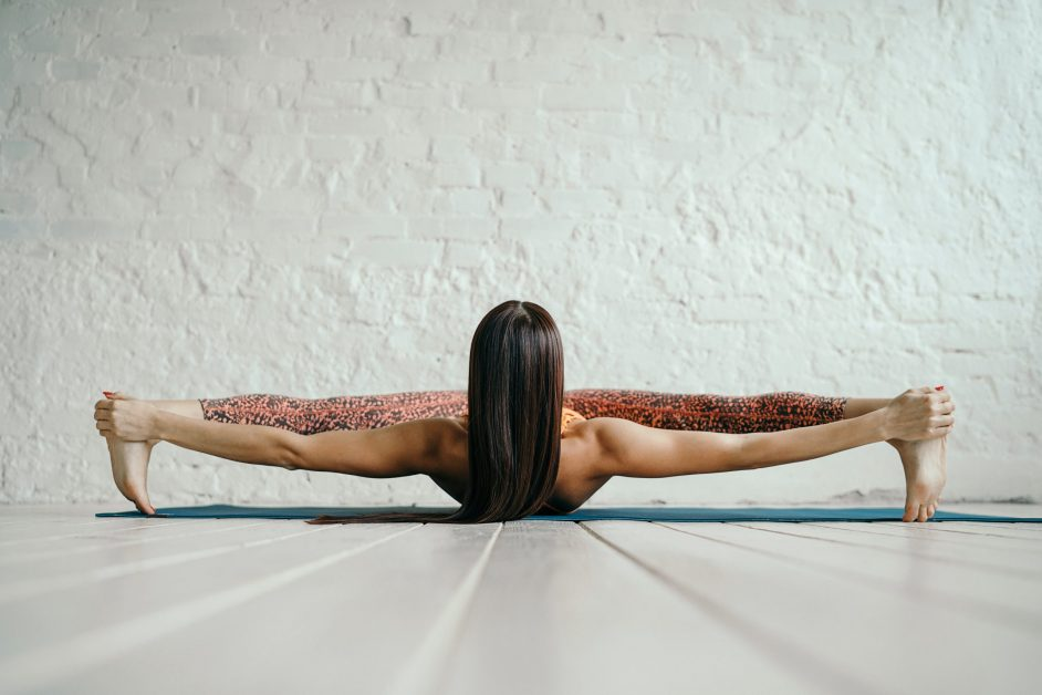 Woman Stretching on White Floor