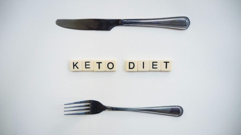 Fork and Knife on White Background With Tiles Spelling Keto Diet