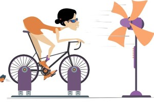 lady riding an exercise bike