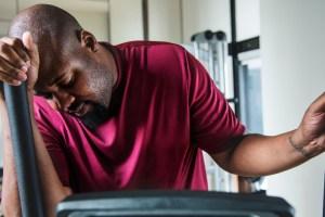 man bored at exercising