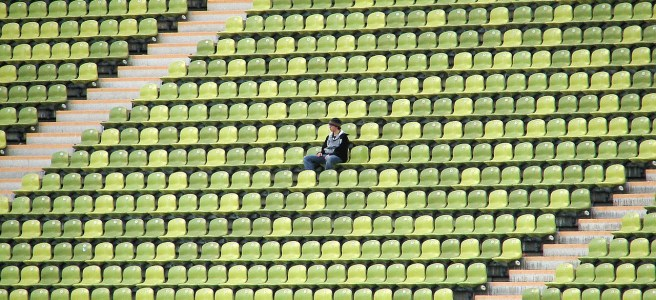 sitting alone in a crowd