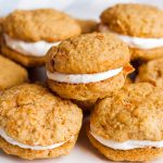 close up view of carrot cake cookie sandwiches