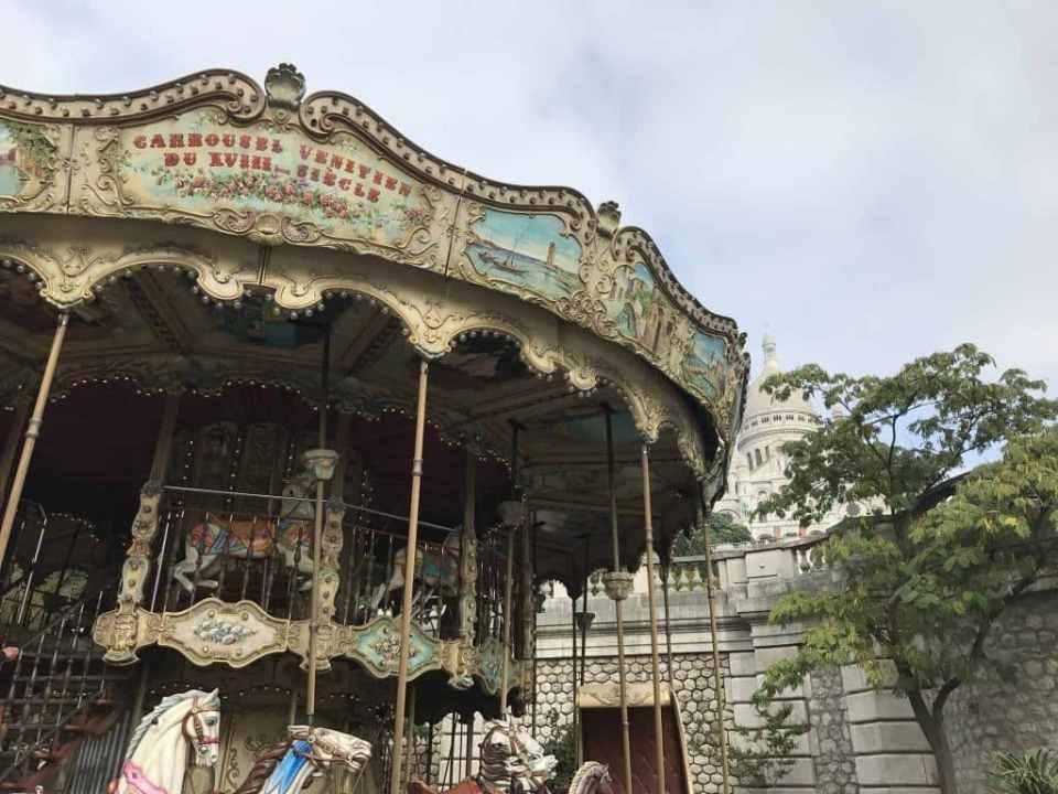 Carousel at the base of Sacre Coeur Basilica in Paris