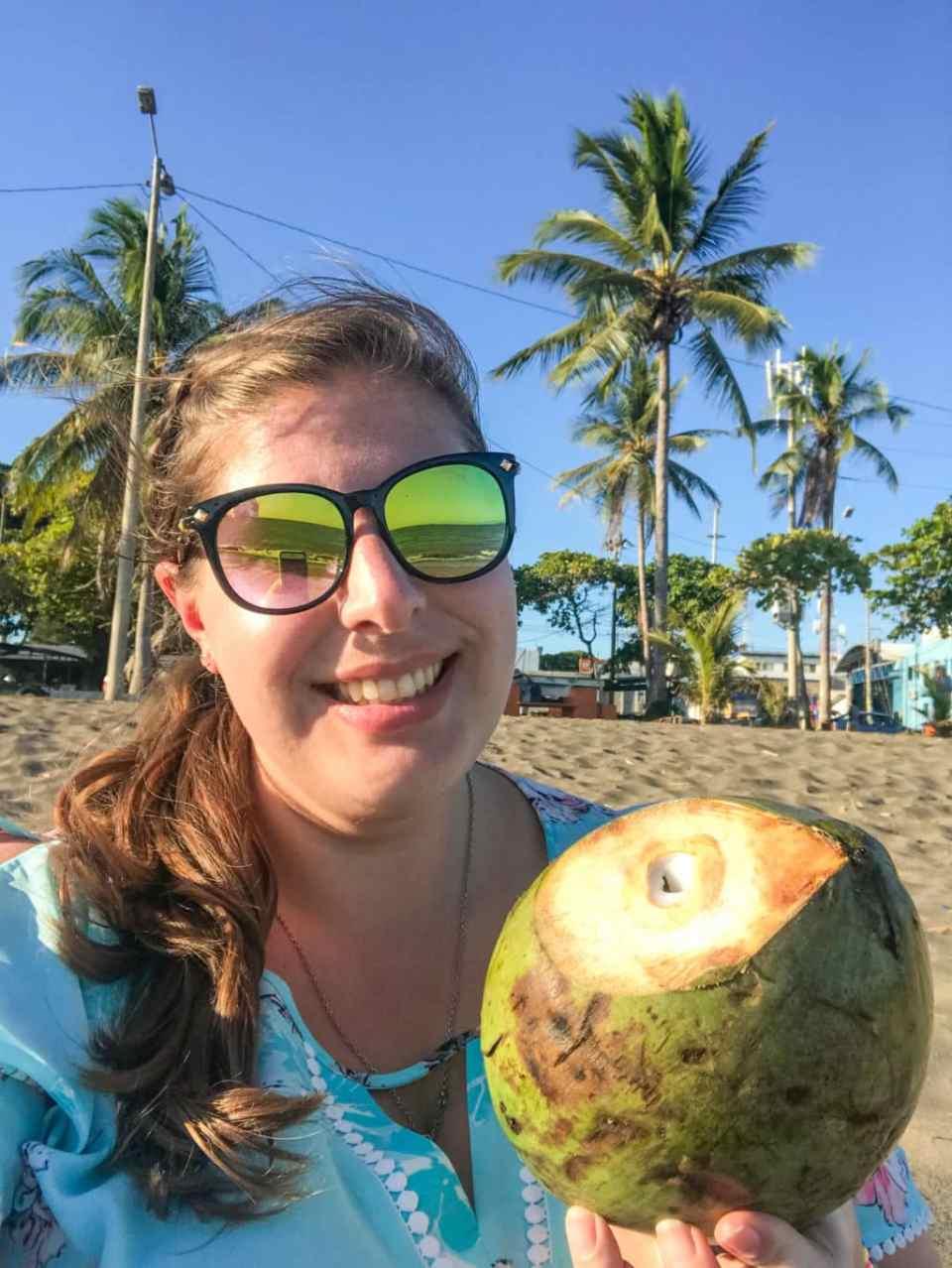 Holding a coconut in Costa Rica