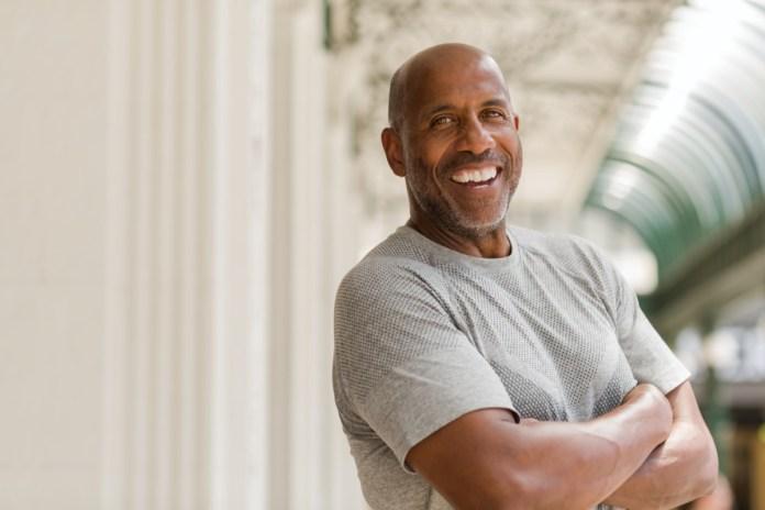 Mature African American man smiling.