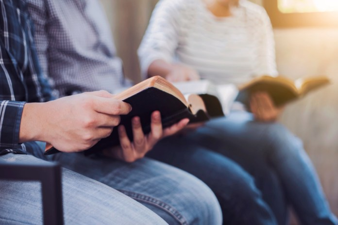 friends group reading and study bible together