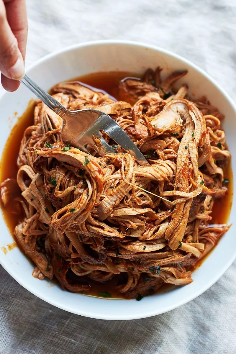 Slow Cooker BBQ Pork – The most amazing FALL-APART TENDER pork goodness! Cooked low and slow right in the crockpot!