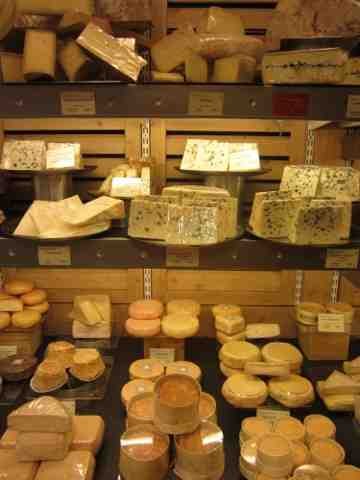 Picking cheeses in a Paris shop