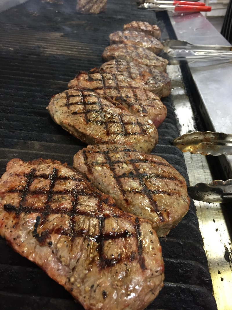Making the perfect criss-cross on steaks at Miller & Carter, Birmingham