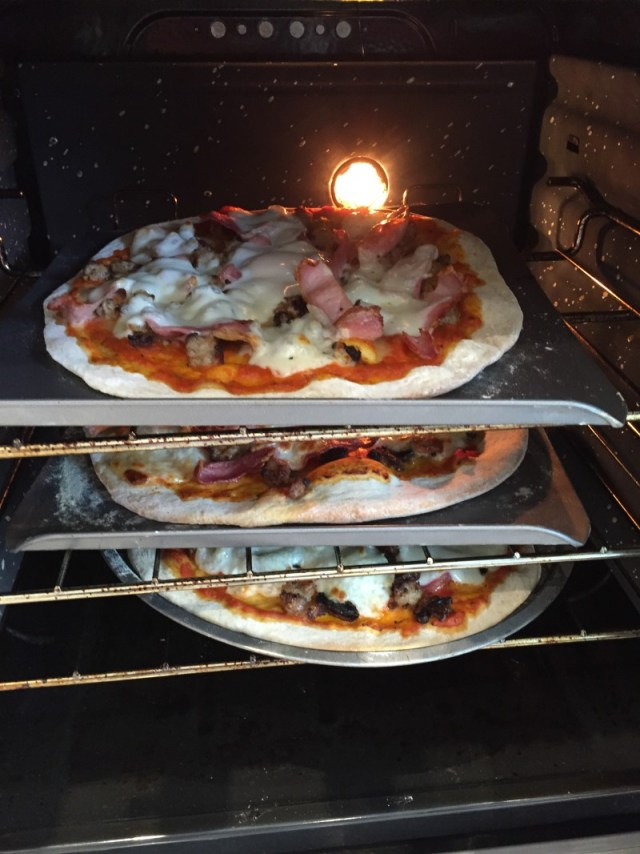 Breakfast pizzas cooking in the oven