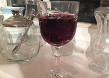 A glass of homemade sloe gin