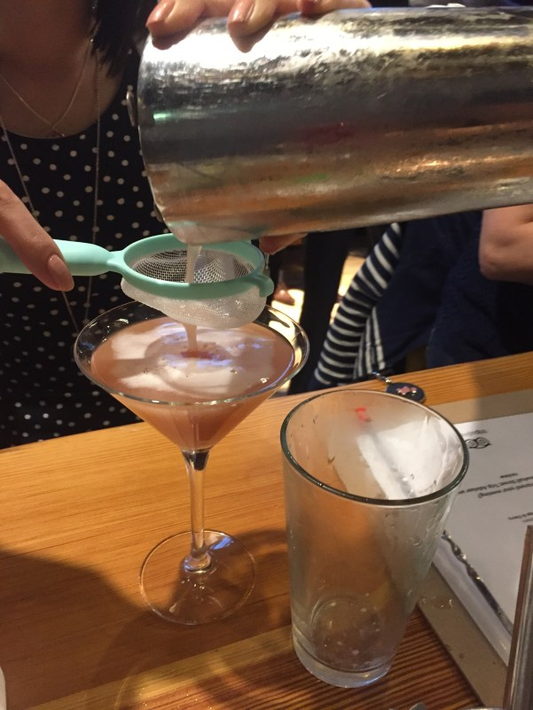 Straining a french martini at All Bar One