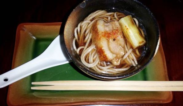 Buckwheat soba noodles with duck breast and grilled green onion in bonito and duck broth dash