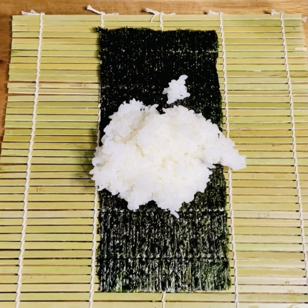 Sushi Rice on Nori Seaweed Placed on Makisu - Sushi Roll - EATwithOAHSHI.com