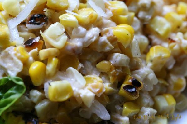 Grilled corn in creamy sriracha closer
