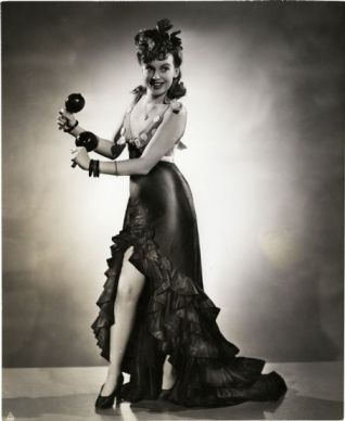 Joan Leslie dancing with maracas