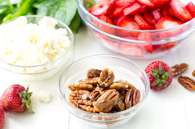 Fresh ingredients in Strawberry Pecan Spinach Salad with a balsamic vinaigrette