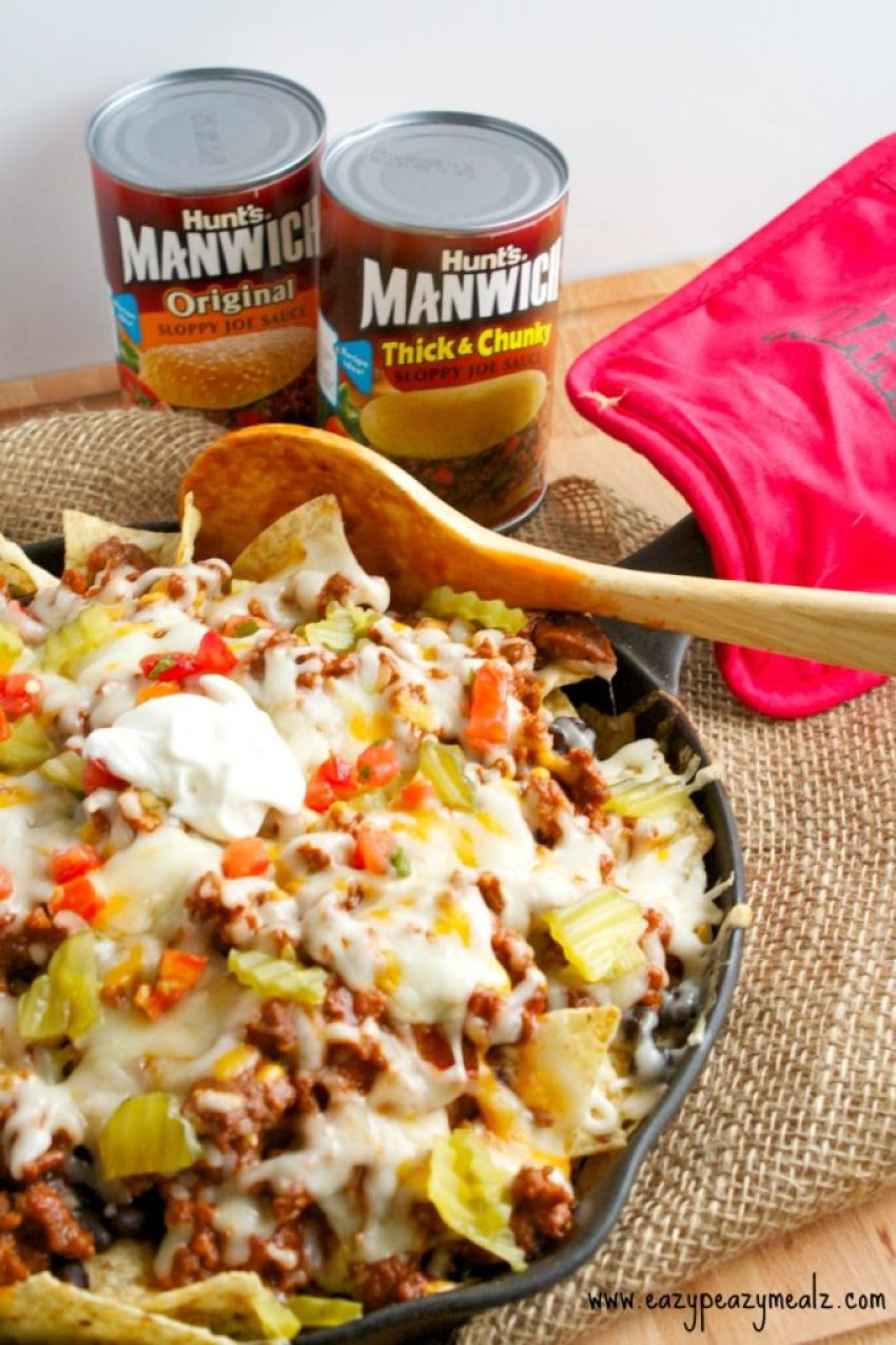 Manwich Sloppy Joe Nachos: Ground beef with a sweet and tangy sauce, crispy chips, black beans, dill pickles, and of course plenty of cheese, sour cream and pico, make this a messy-licious meal kids and parents love!