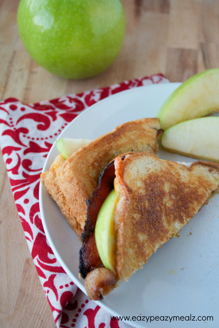 sliced abc grilled cheese, apples, bacon, and cheddar cheese grilled cheese sandwich