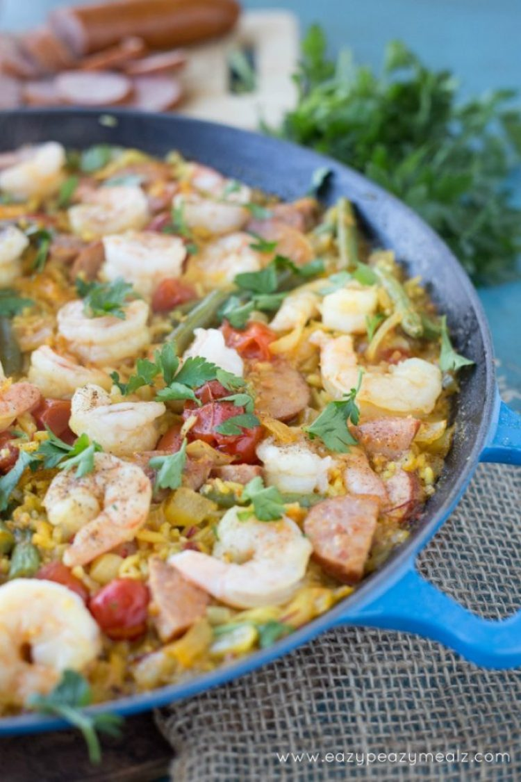 Easy Spanish Paella Recipe: Saffron infused rice, hearty sausage, prawns, and fresh green beans! This Spanish Paella will take your tastebuds on a Valencian vacation.