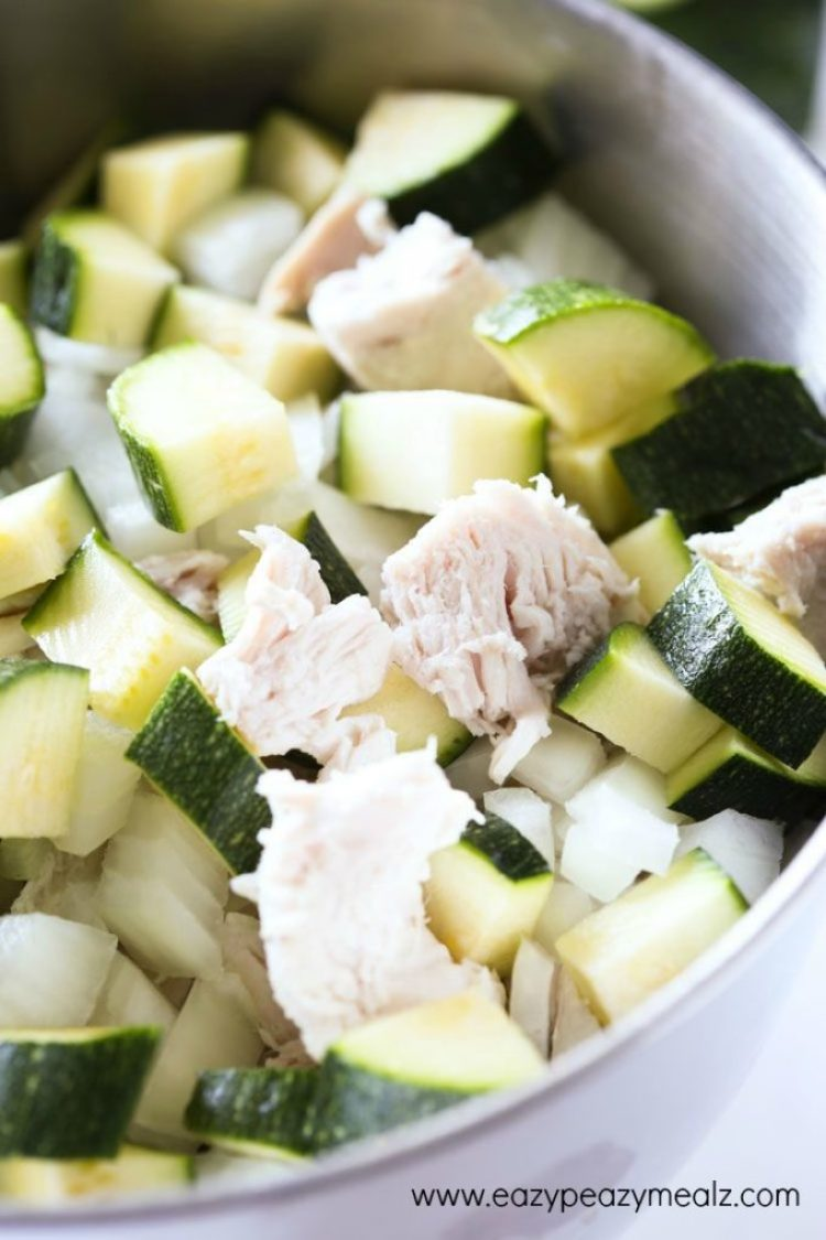 Cheesy Turkey Zucchini Casserole: zucchini, turkey, and onion in a silver pot ready to be baked into a casserole
