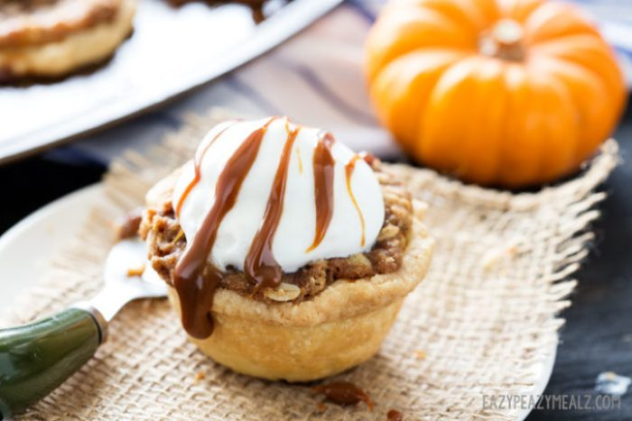 Oatmeal Caramel Crumble atop of a mini muffin tin pumpkin pie