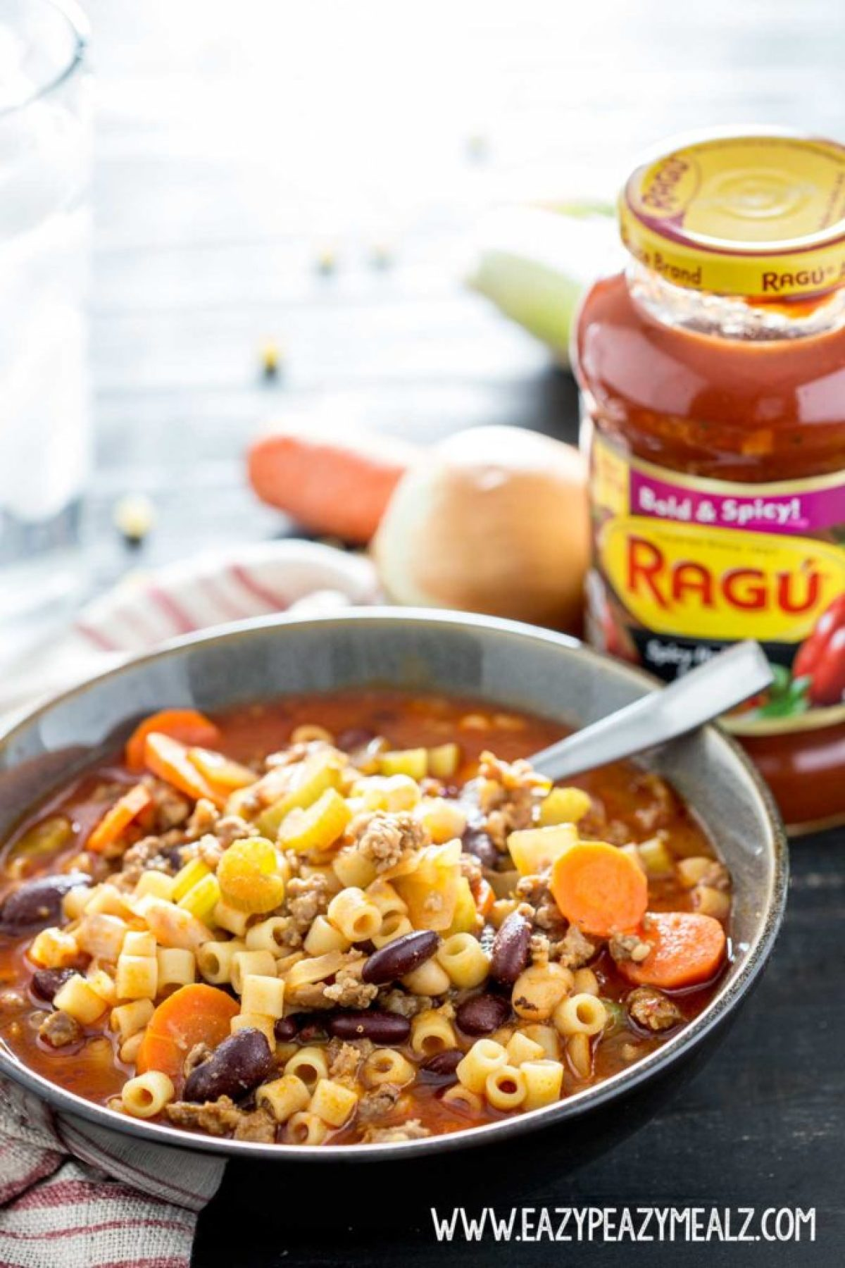 Pasta Fagioli Soup Olive Garden Recipe: This hearty, flavorful soup made from Italian Sausage, veggies, marinara base, pasta and beans can be on the table in under 30 minutes.