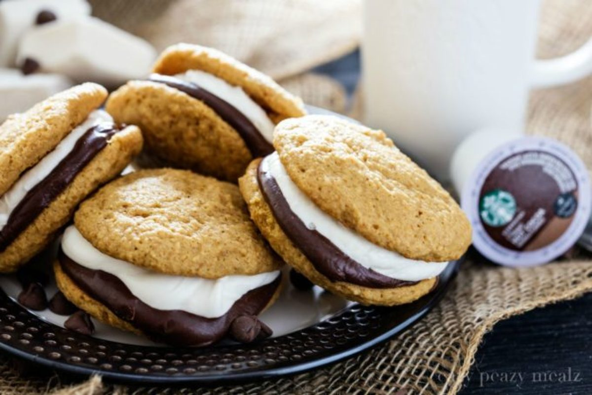 S'mores Whoopie Pie by the plateful! Graham cracker cake cookies with chocolate ganache and a tasty marshmallow buttercream, that perfectly compliments the new Starbucks® Hot Cocoa K-Cup® pods.