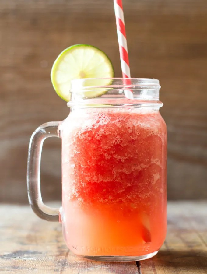 An insanely delicious recipe for a homemade healthy Watermelon Slush that surpasses all kids requirements: sweet, colorful, refreshing and fun! And all that with less than 5 minutes prep!