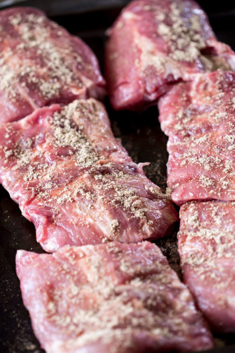 Confession time, this is a slow cooker recipe, but the slow cooker only does part of the work. Before you put the ribs in the slow cooker to get tender, you have to bake them at a high heat to seal in the moisture, and help them stay tender.