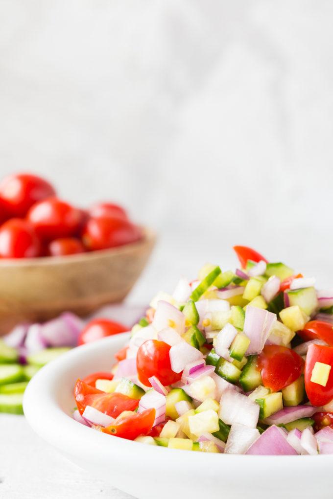 greek chicken nachos ingredients. Tomatoes, olives, onions, etc.