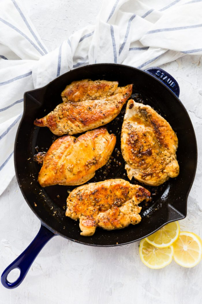 Healthy skillet lemon chicken, cooked to perfection in a cast iron skillet