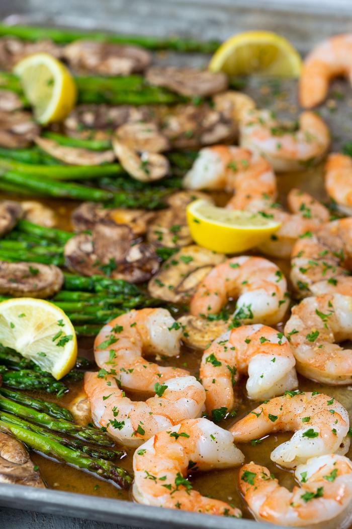 Low calorie sheet pan dinner of honey lemon garlic shrimp and asparagus