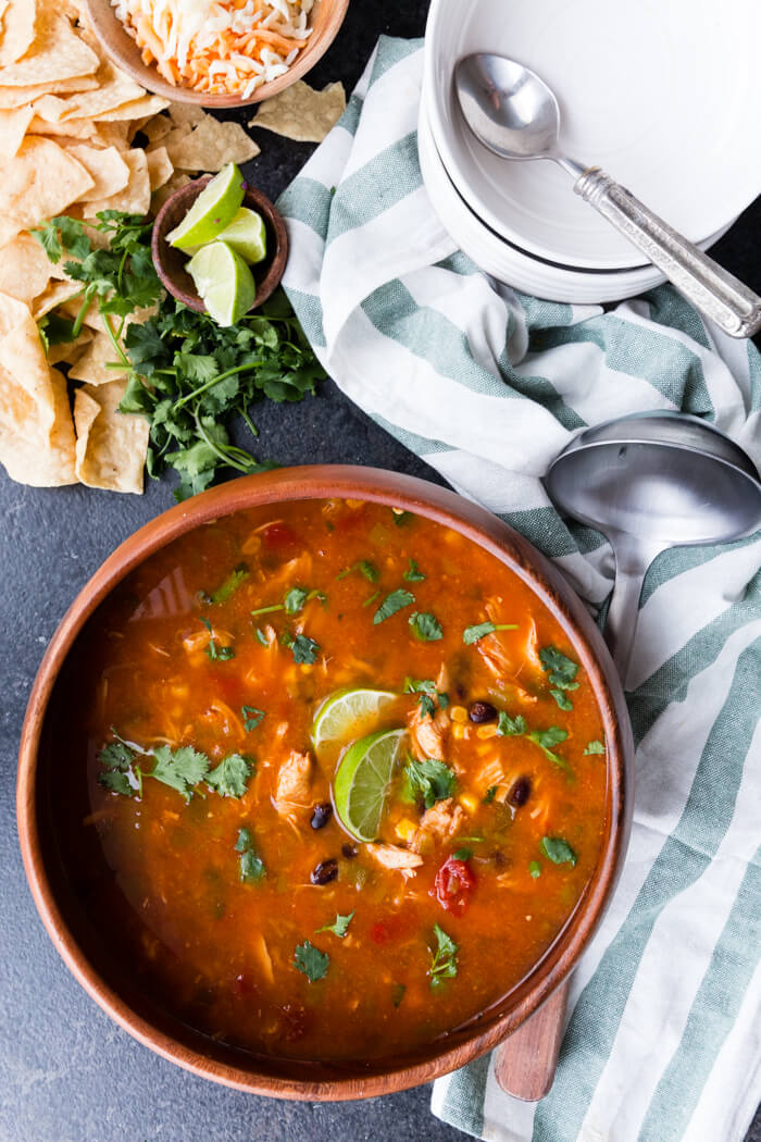 Instant Pot Chicken Taco Soup is a rich and flavorful broth and all the fixings like chicken, beans, and corn