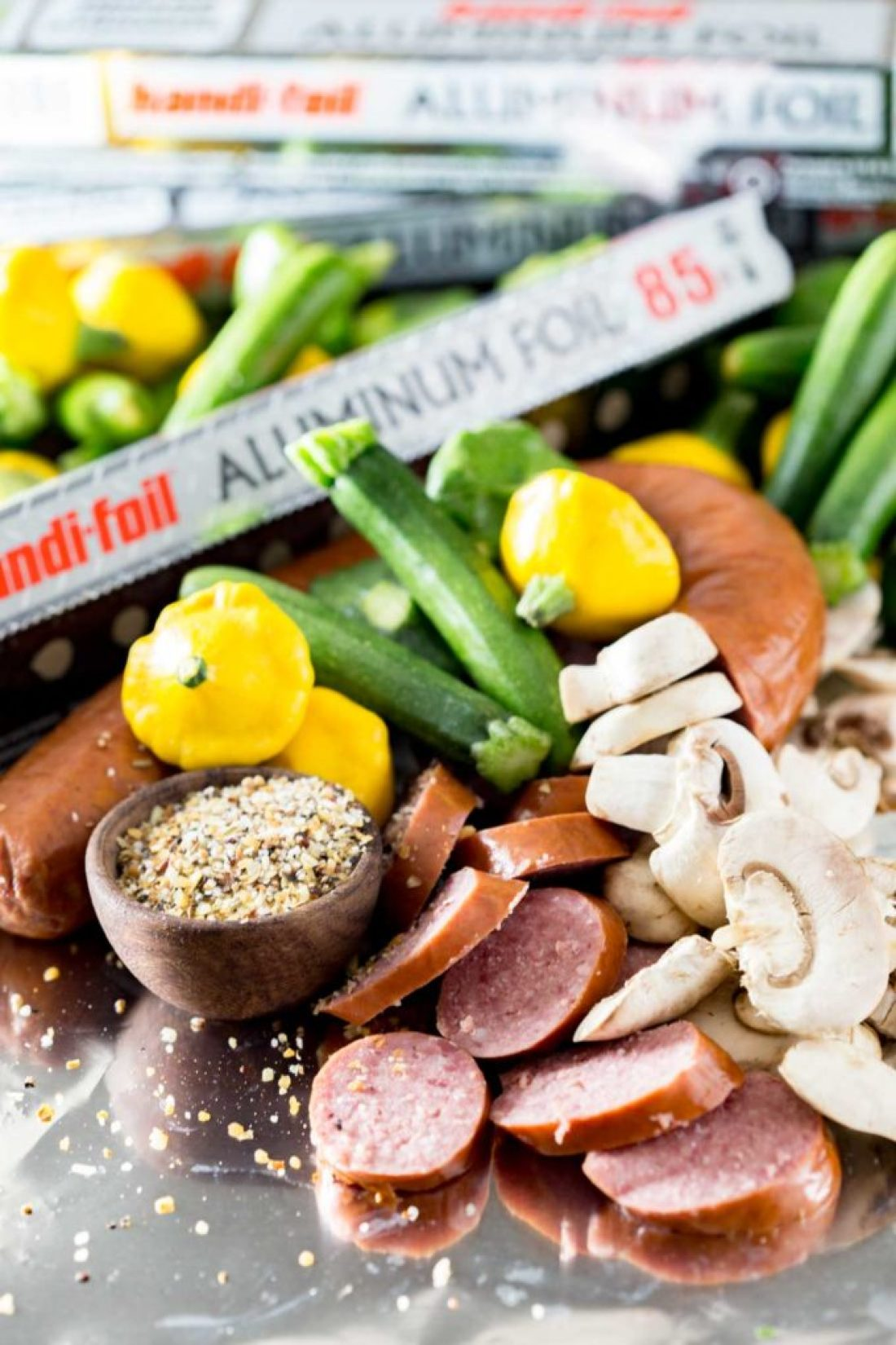 Kielbasa Recipes: Kielbasa sausage and fresh garden yellow squash and zucchini, and mushrooms, lightly seasoned, and cooked in Handi-Foil for the perfect, simple meal.