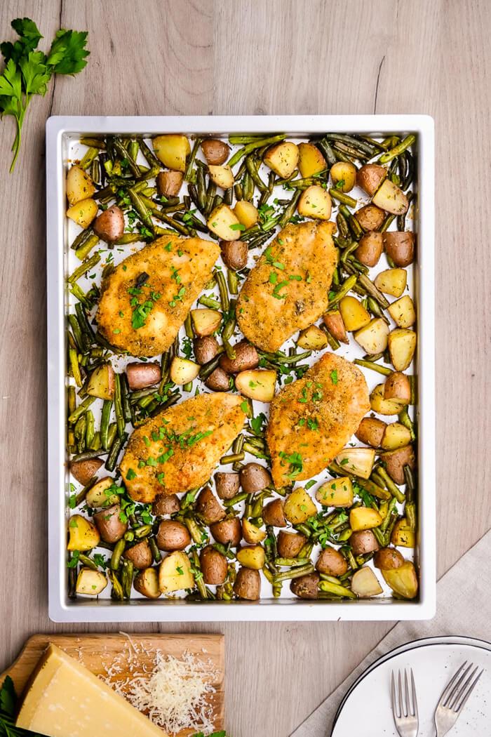 Sheet Pan Parmesan Chicken and Veggies: A single sheet pan is all it takes to bake this sheet pan parmesan chicken and veggie spread!