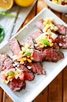 Steak marinated in greek seasoning with a corn and feta relish
