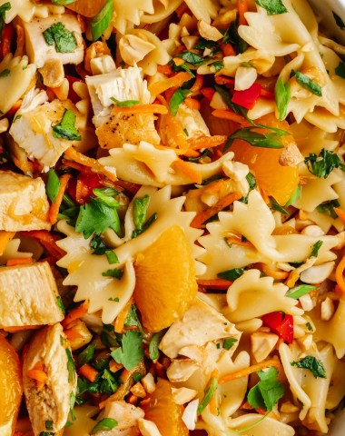 A close up of the pasta, chicken, mandarins, and other ingredients in Asian Pasta Salad